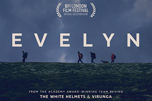 Evelyn movie poster, showing four people walking along a ridge