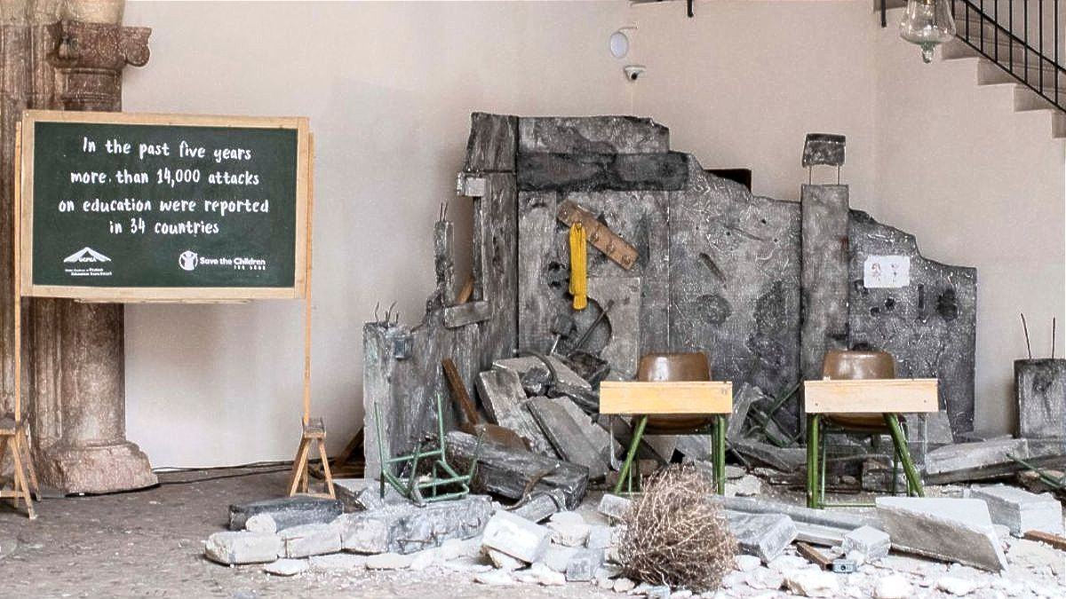 An installation of a bombed-out classroom was placed in Can Balaguer Cultural Centre for the Third International Conference on Safe Schools' welcome reception.  Copyright Ministry of Foreign Affairs, European Union and Cooperation of Spain.