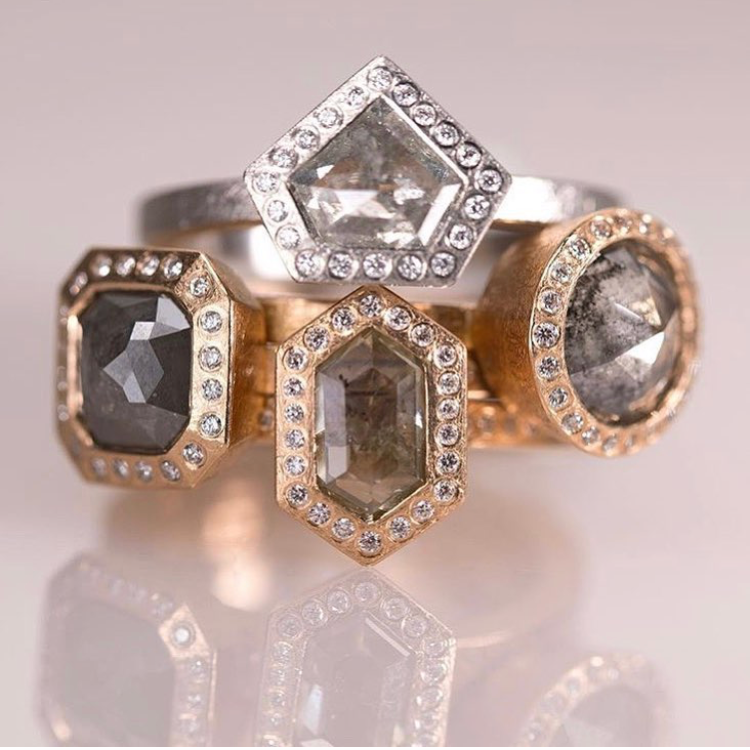 3 natural color diamond rose gold rings with a palladium natural diamond sitting on top