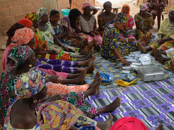 Women gathered around a cashbox