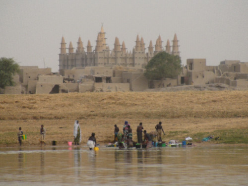 People using the river in front of Saba village, Mali