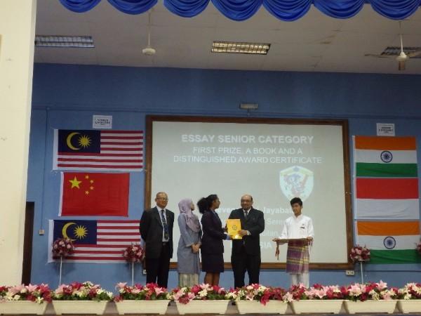 First place winner Preevena Devi Jayabalan receives her prize