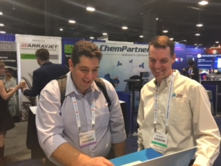 Will Stokes with a customer at PEGS Boston