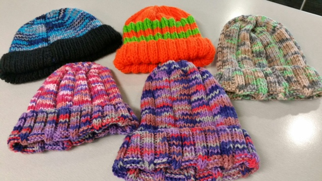 Beanies donated to the Early Morning Centre by a group of Tuggeranong knitters