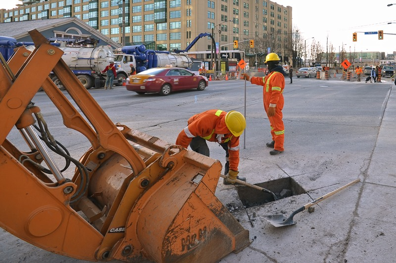 Digging a test pit on Queens Quay.