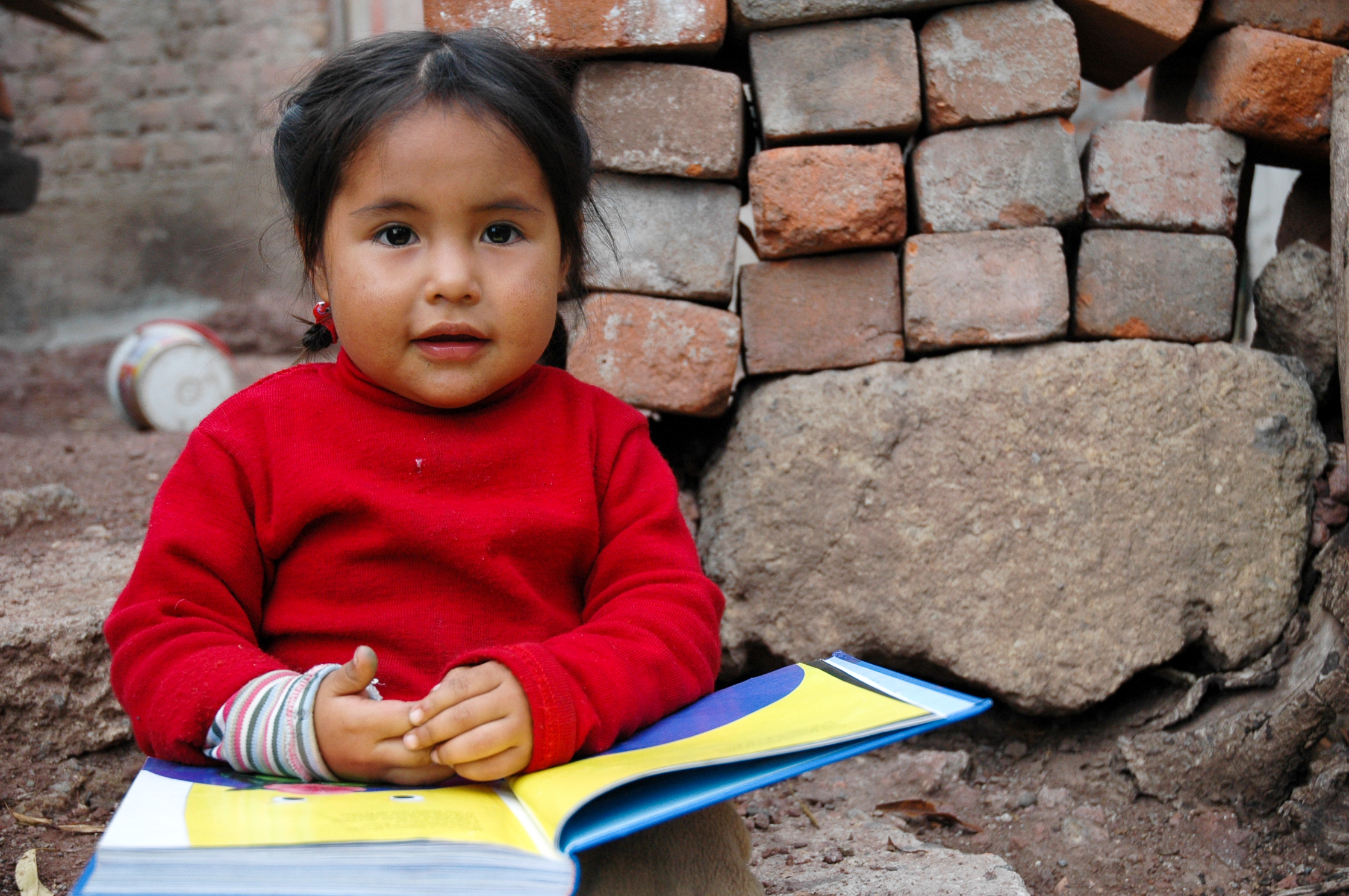 Young child with open book on her lap