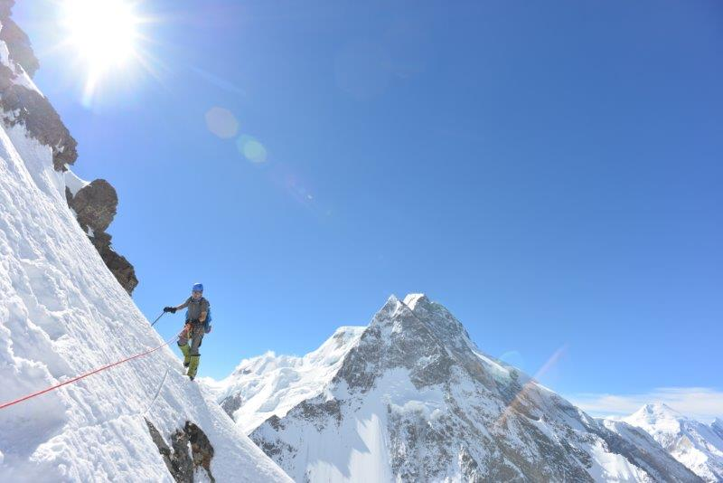 Bo climbing up to K2 Camp 2 with Broad Peak in the background