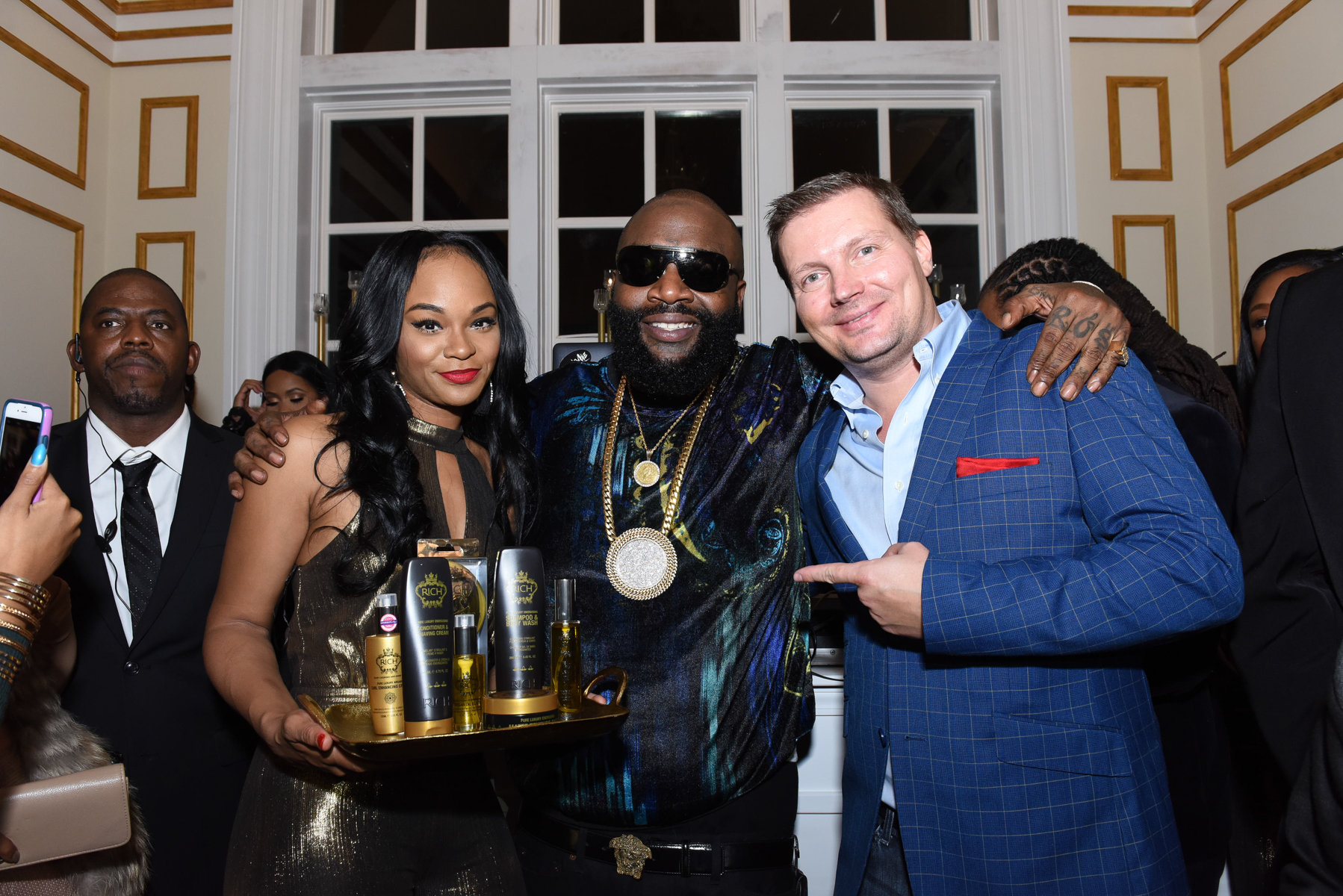 Rick Ross and his business partner celebrate at Rick's house