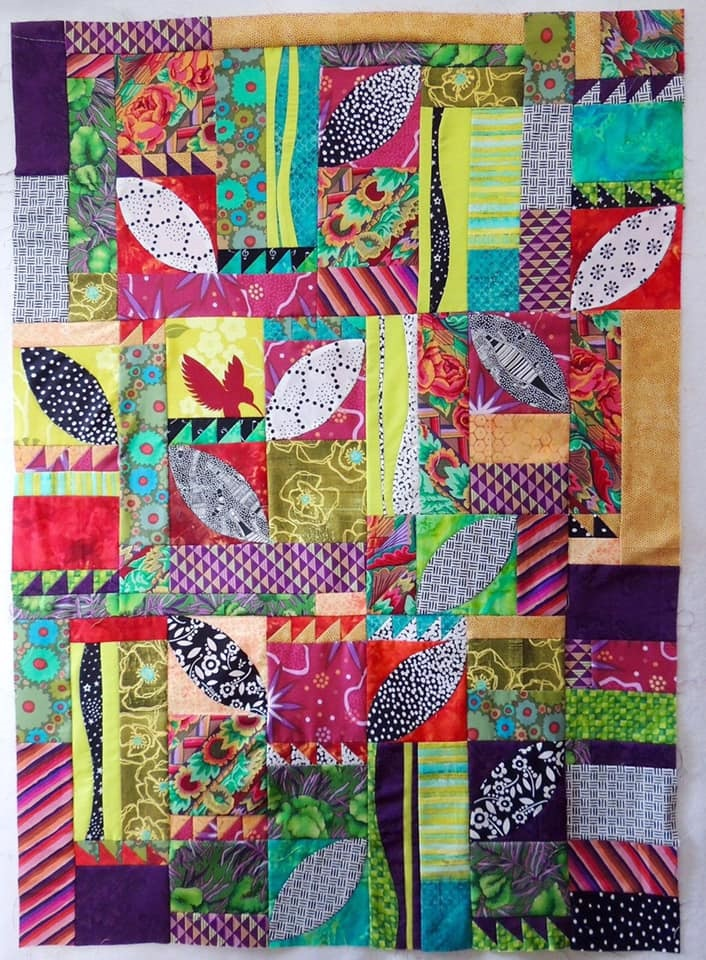 Colorful quilt with leaf pattern
