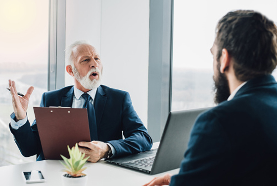 older manager arguing with employee