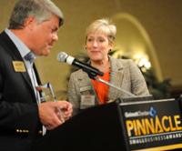 Susan Bacon receiving Amazing Entrepreneur Award