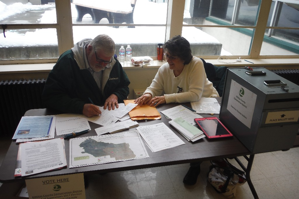 Ted Mildon and Betty Douglas were two of the eight polling officers who assisted with the election