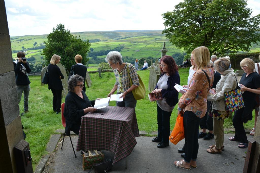 Poet Laureate Carol Ann Duffy signing books at St Chads