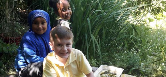 Three children at the Centre for Wildlife Gardening