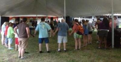 Team members pray over the fairgrounds before the Expo begins!!
