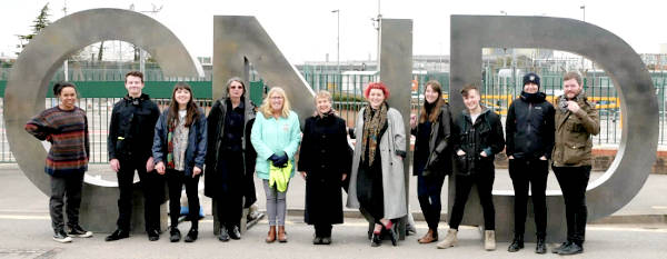 An image showing CND staff members in front of the CND symbol
