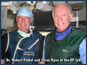 Steve Ryan and Dr. Robert Fishel dressed for the EP Lab before performing an ablation procedure for Atrial Fibrillation