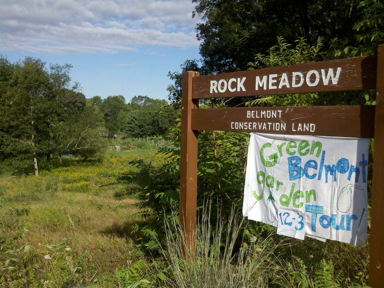 Rock Meadow sign with Belmont's Victory Gardens in the background.