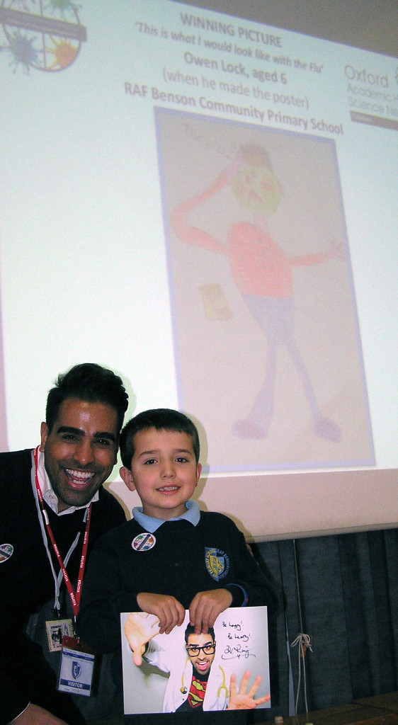 Dr Ranj with flu poster competition winner Owen Lock aged seven
