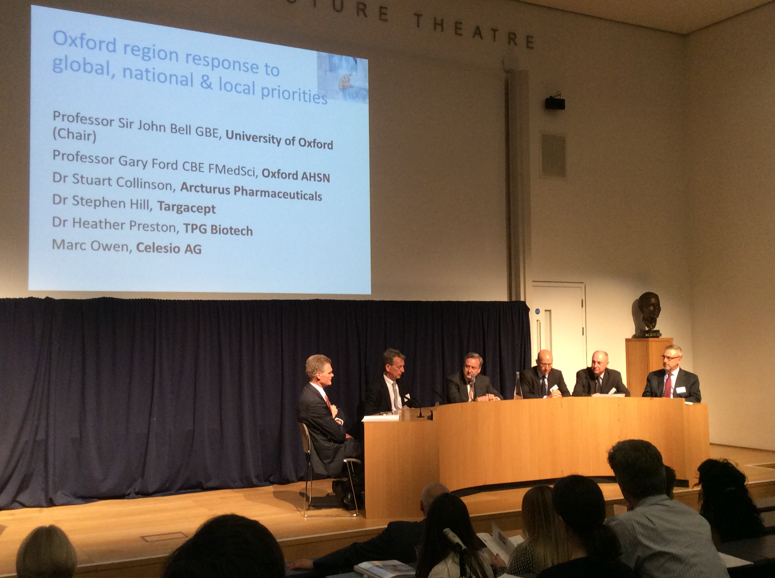 Prof John Bell, left, chairs a panel at the Oxford AHSN Alumni Summit
