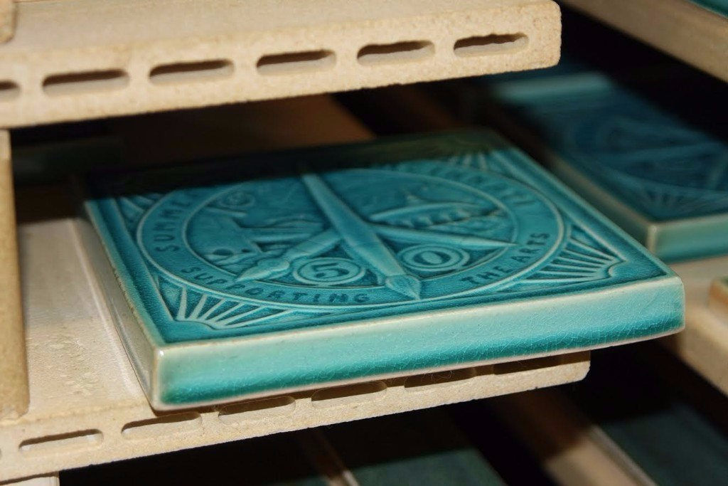Summerfair Turns 50 tile coming out of kiln