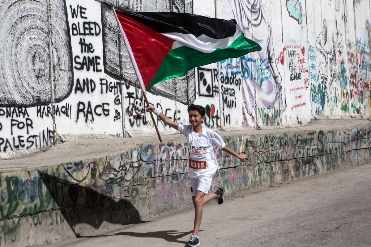 Palestinian Child running in the annual Palestine Marathon