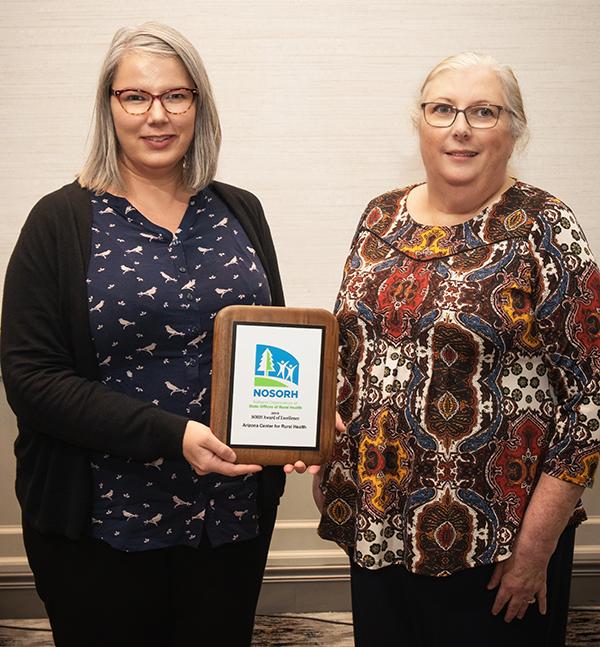 Jennifer Peters receiving award on behalf of AzCRH