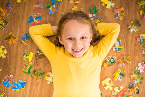 Girl with jigsaw puzzle
