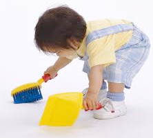 toddler sweeping up