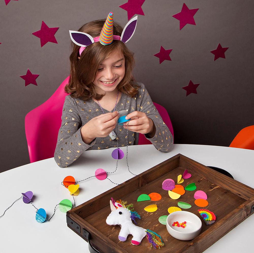 Girl making unicorn crafts