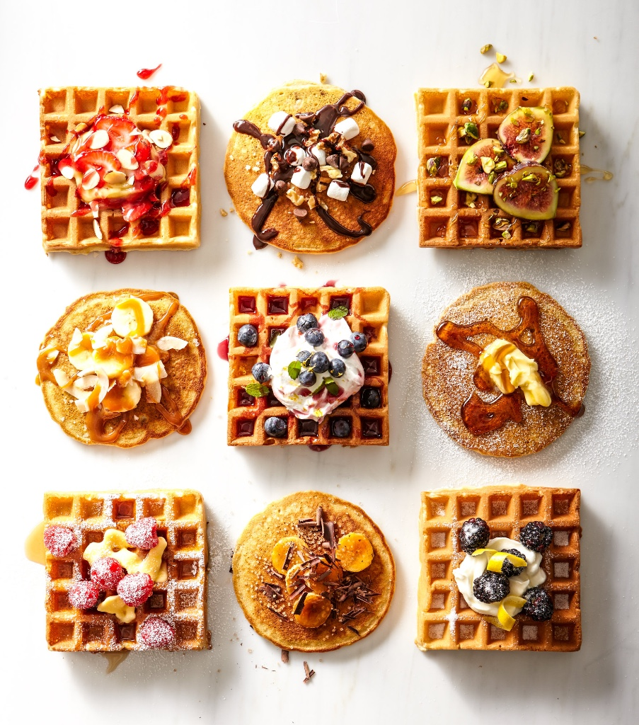 Waffles and pancakes arranged graphically with a variety of toppings, from photographer Christina Schmidhofer