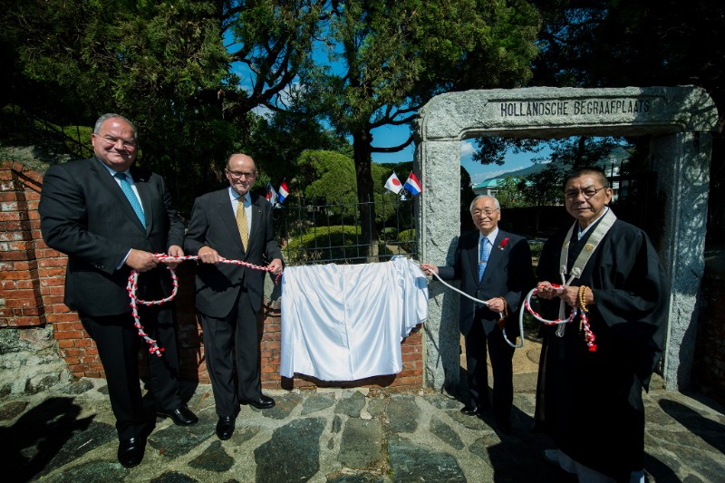 Revealing the information plaque at the Dutch Cemetery in Nagasaki, Japan.
