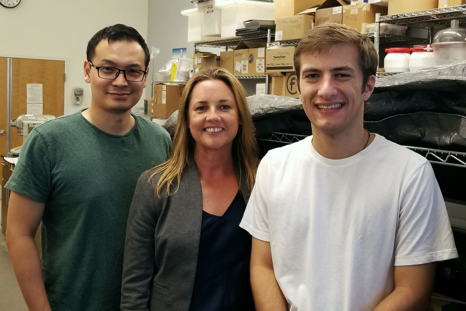 Bill Jin, Dr. Kimberly Kurtis and Sam Lucas in the laboratory.