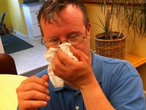 Man blows his nose