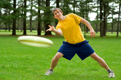 man throwing frisbee