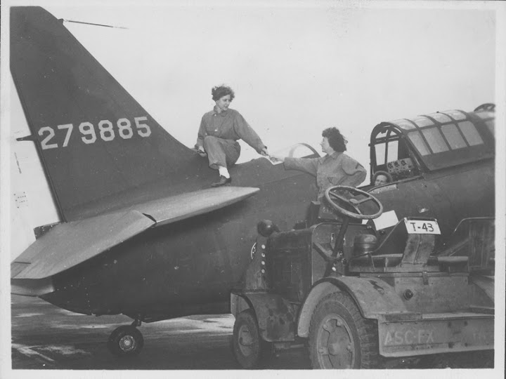 Women's Army Corps (WACS) servicewomen L. Weber, Esther Fromm, and Marvyl working on a plane at Patterson Field. Circa 1944. Courtesy of ONE National Gay & Lesbian Archives at USC Libraries.