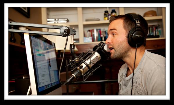 John Lee Dumas at the microphone.