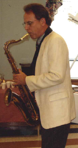 CMI focus area leader Bruce Moyer plays a saxaphone.