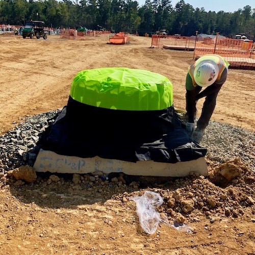 Fill Silt Saver Dome with stones to weight it in place