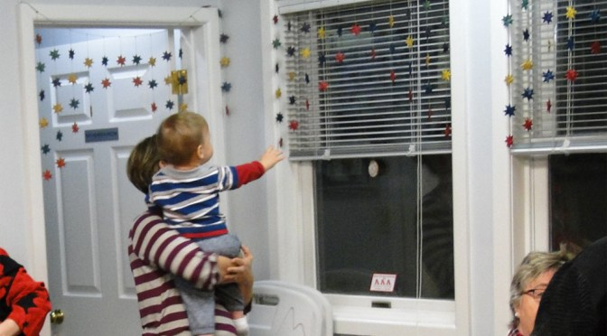 toddler at CCS reaching for the stars