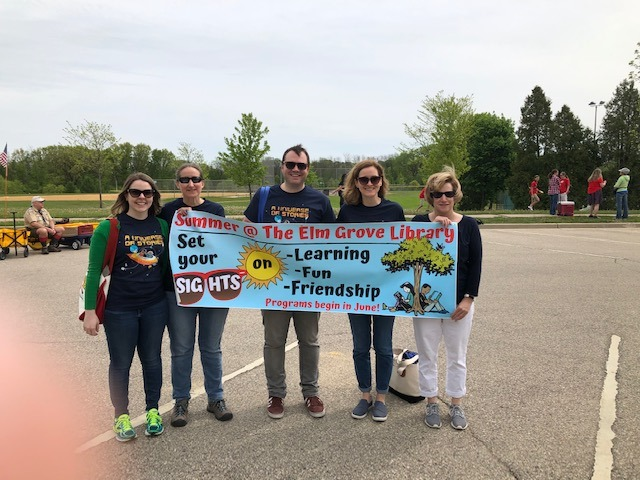 Group of staff holding a banner for the Elm Grove Library