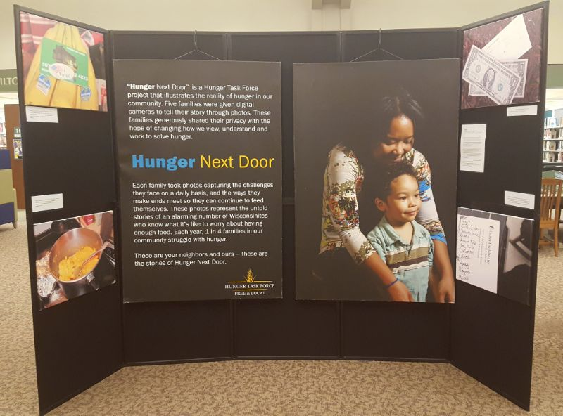 """Exhibit board with photos and title """"Hunger Next Door"""""""