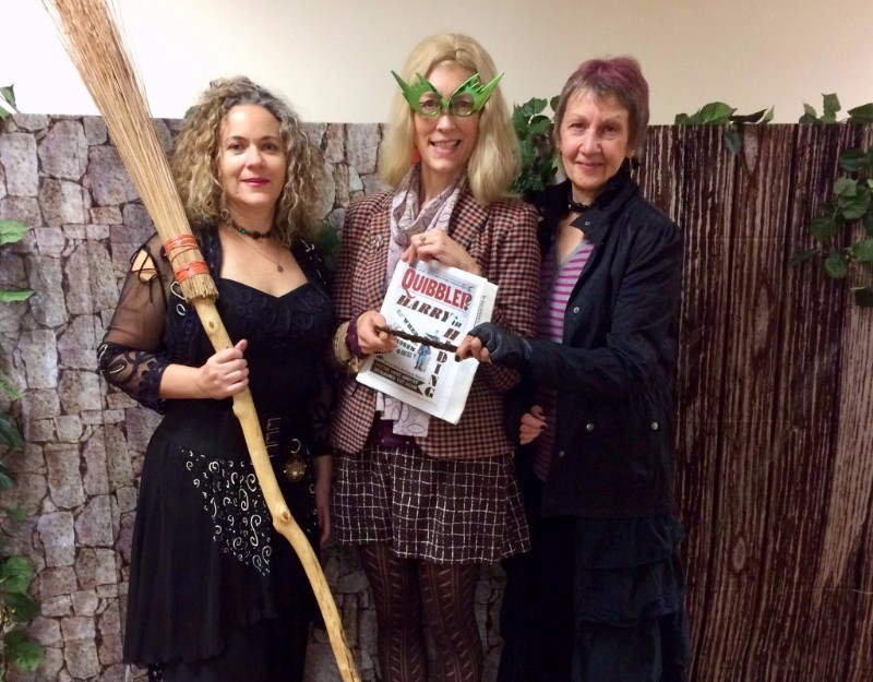 Three librarians posing, dressed up as Bellatrix Lestrange, Luna Lovegood, and Tonks