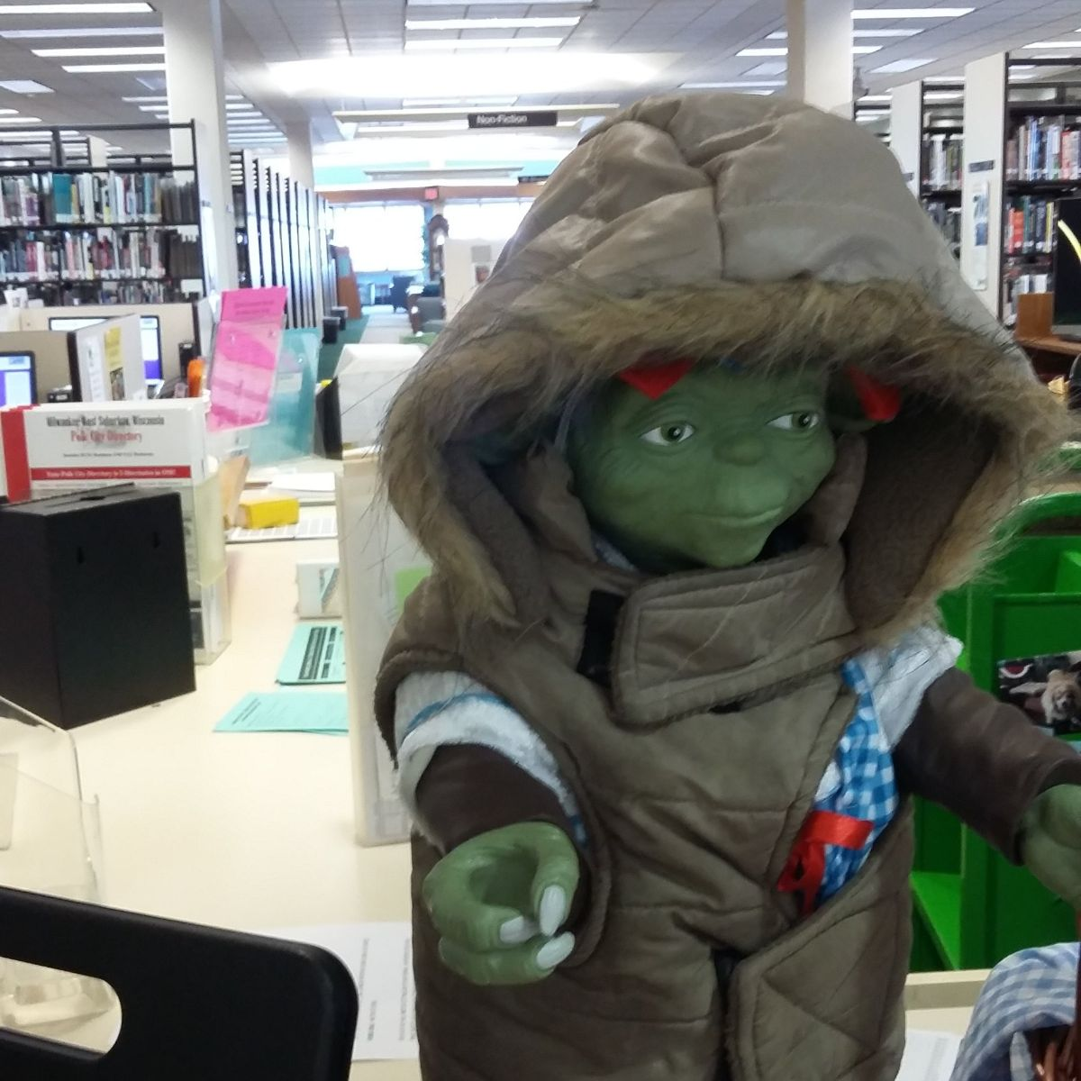 Yoda figurine doll with a little coat on