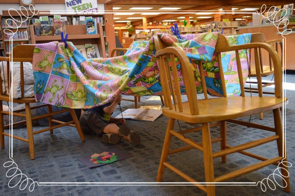 A blanket draped over chairs in the middle of the library