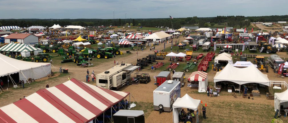 Aerial view of tents, trailers, and tractors from a Farm Tech Days show