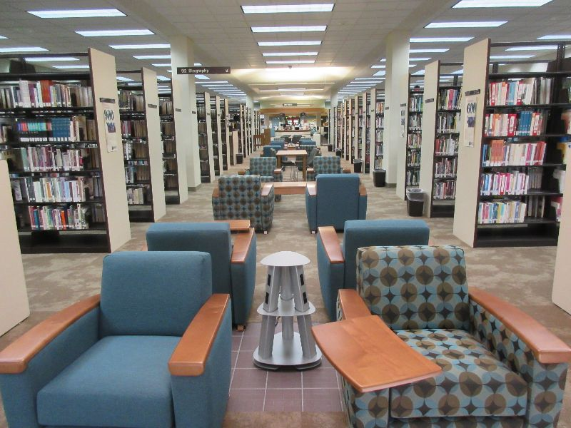 Row of bookshelves and chairs in a library