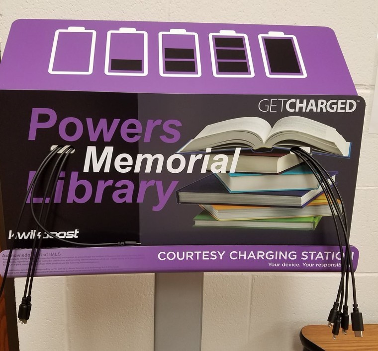 """Charging station labeled """"Powers Memorial Library"""""""
