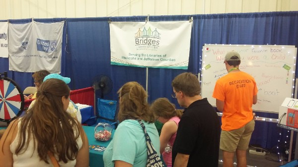 Group of people stopping by the Waukesha County Fair booth