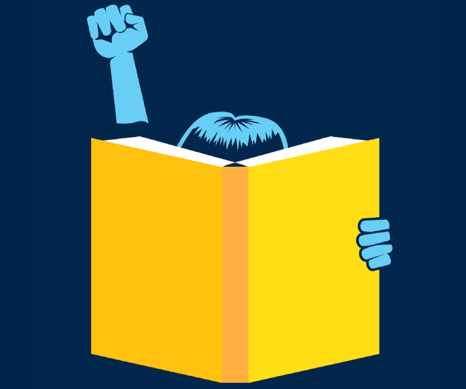 Person holding a book with fist in the air